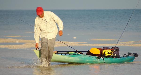 Kayak Fisherman Walking Out His Kayak