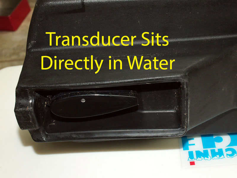 Transducer Sits In Water In Tackle Pod