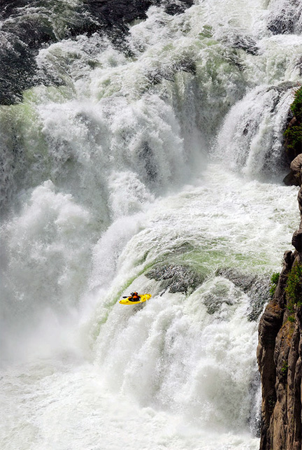 Kayaker Going Over Thunderous Falls