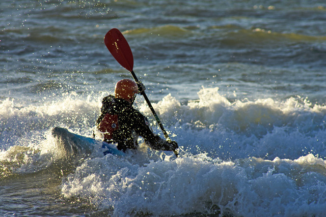 Kayaker Crashing Through Surf
