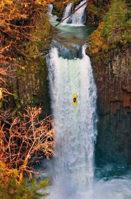 Kayaker Experiencing Long Drop Over Falls