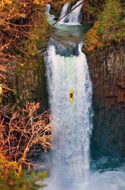 Kayaker Experiencing Long Drop Over Falls